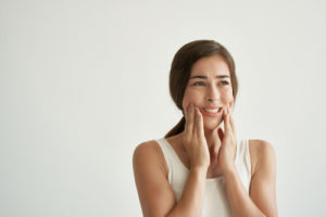 woman in pain would like to prevent jaw clenching
